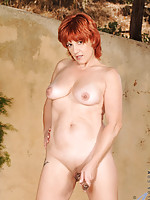 Redheaded Anilos woman inserts a glass dildo deep inside of her mature cougar pussy